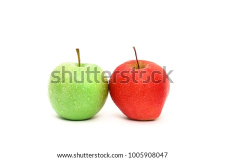 A pair of fresh washed apples, one green and one red, touching. Isolated on white background