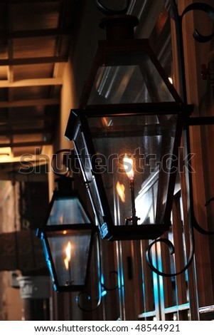 A pair of gas lamps at night in the French Quarter of New Orleans, Louisiana