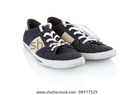 A pair of generic Classic black sneakers isolated on white background - stock photo
