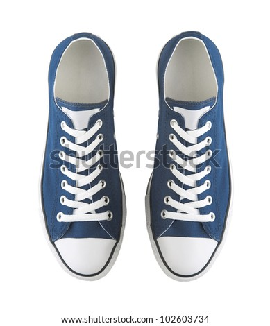 A pair of generic sneakers isolated on white - stock photo
