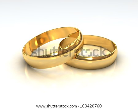 A pair of golden wedding rings layered on each other. - stock photo