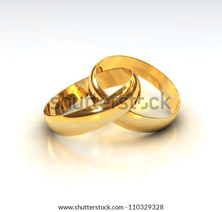 A Pair of golden Wedding Rings on white background - stock photo