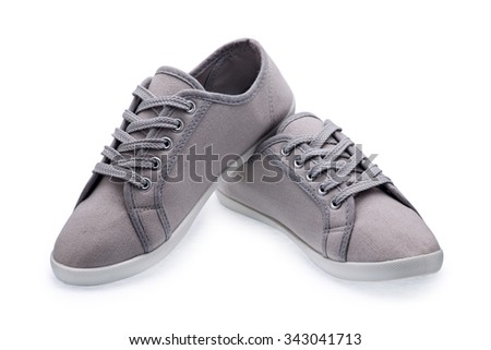 A pair of gray gumshoes with shoelace on a white background