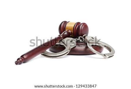 A pair of handcuffs and gavel