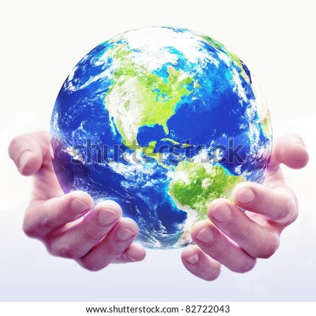 A pair of hands hold a globe with white background - stock photo