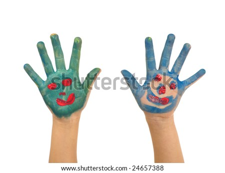 A pair of hands painted with faces. - stock photo