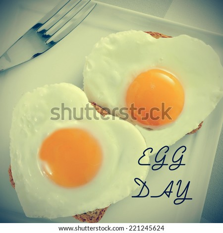 a pair of heart-shaped fried eggs on bread and the text egg day, for the world egg day, with a retro effect - stock photo