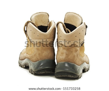 A pair of hiking boots from the back. Isolated on white background - stock photo
