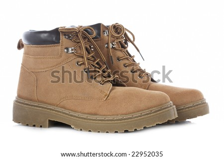 A pair of hiking boots isolated on white background. Shallow depth of field