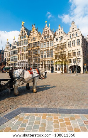 A pair of horses add charm to the famous medieval Guild Houses of Antwerp, Belgium - stock photo