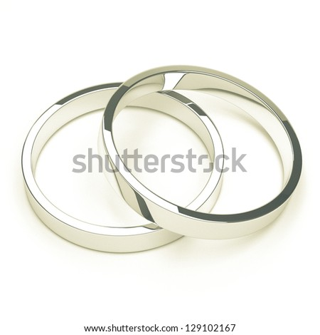 A pair of isolated silver or platinum weddings rings.