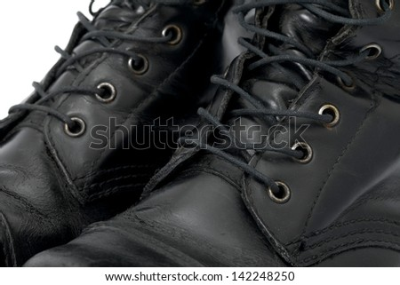 A pair of leather boots closeup - stock photo