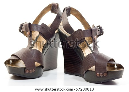 A pair of leather platform sandals - stock photo