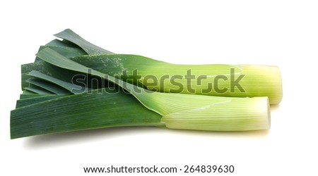 a pair of leeks on white background  - stock photo