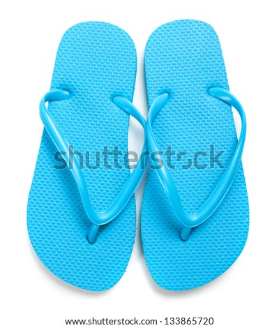 A pair of light blue flipflops on a white background - stock photo