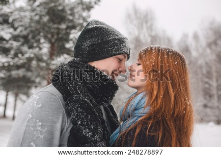 a pair of lovers in a snowy forest