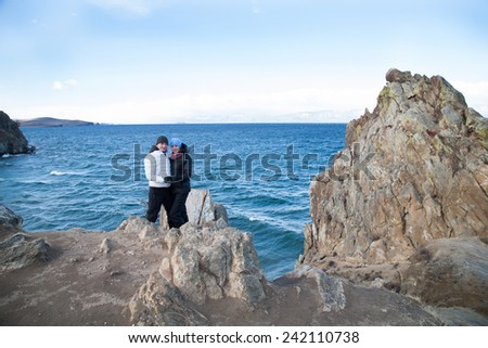 A pair of lovers on the shore of Lake Baikal. autumn