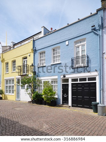 A pair of mews houses converted from an eighteenth century terrace of stable carriage buildings in Kensington, London, UK. - stock photo