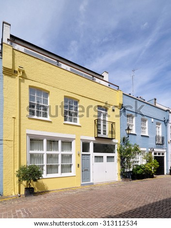 A pair of mews houses converted from an 18th century terrace of stable carriage buildings in Kensington, London, UK. - stock photo