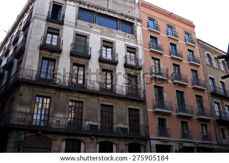 A pair of old apartment blocks in an urban setting. - stock photo