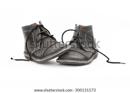 A pair of Old Black male shoes isolated on white