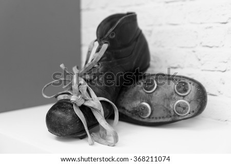 A pair of old football boots. - stock photo