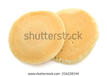 a pair of pancake on white background  - stock photo