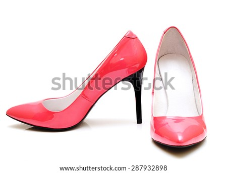 a pair of pink high heel shoes isolated on white - stock photo
