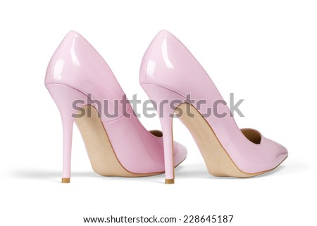 A pair of pink women's heel shoes isolated over white with clipping path.
