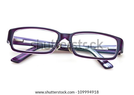 A pair of purple glasses - stock photo