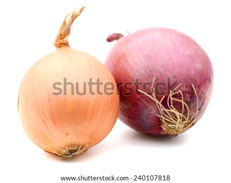 A pair of red and gold onion bulbs isolated on white background  - stock photo
