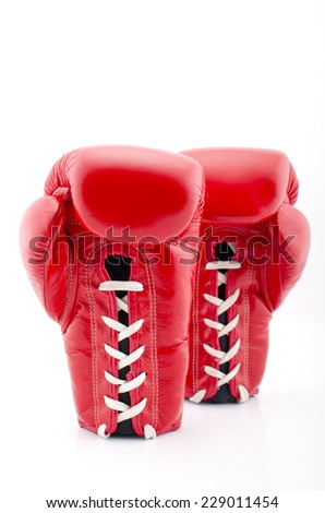 A pair of Red Boxing Gloves on a white Background - stock photo