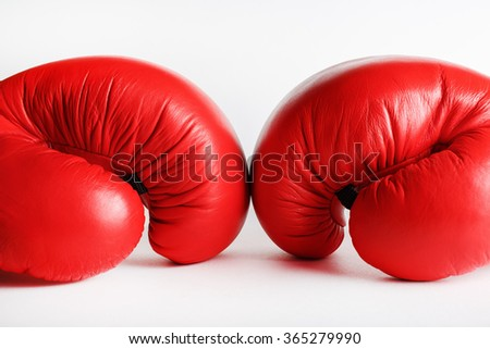 A pair of red boxing gloves. Sports concept. - stock photo