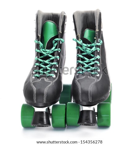 a pair of roller skates on a white background - stock photo