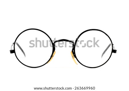 a pair of round-lens eyeglasses on a white background - stock photo