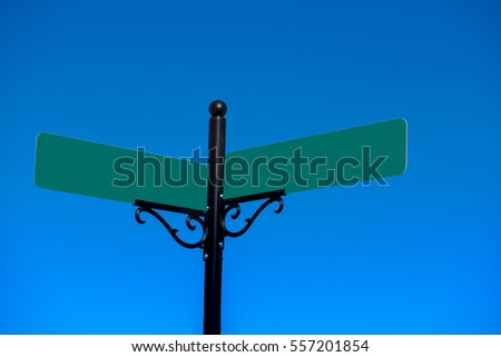 A pair of sign post with space for text