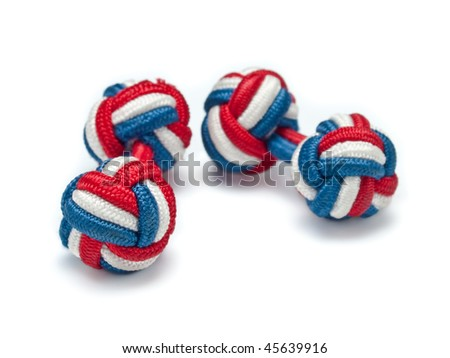A pair of silk knot style cuff links with red, white, and blue stripes - stock photo