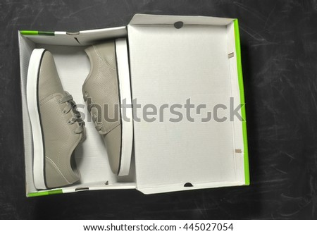 a pair of sneakers in a box - stock photo