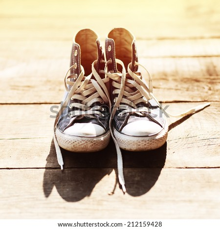 A pair of sneakers, old vintage, sunny - stock photo