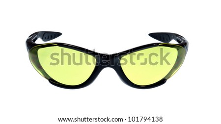 A pair of sport sunglasses with yellow lenses on white background - stock photo