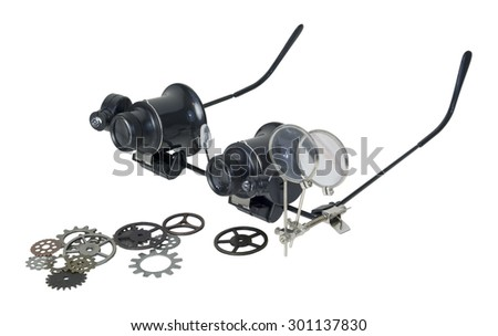 A pair of steampunk glasses used to magnify the fine print with gears - path included - stock photo