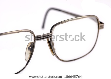 A pair of used glasses, isolated on white.
