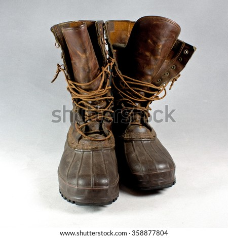 A pair of vintage weather proof hunting boots, front view.