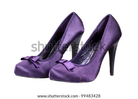 A pair of violet women's heel shoes isolated over white with clipping path. - stock photo