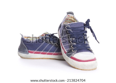 A pair of walking blue sneakers isolated with clipping path - stock photo