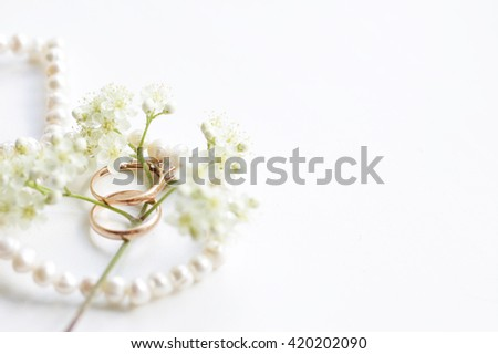 a pair of wedding rings - stock photo