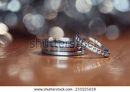 A pair of  wedding rings with bokeh background - stock photo