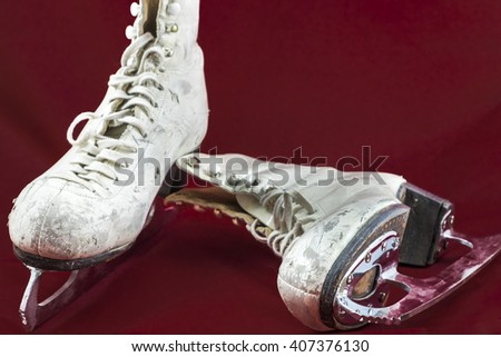 A pair of well used white women's figure skates.  - stock photo