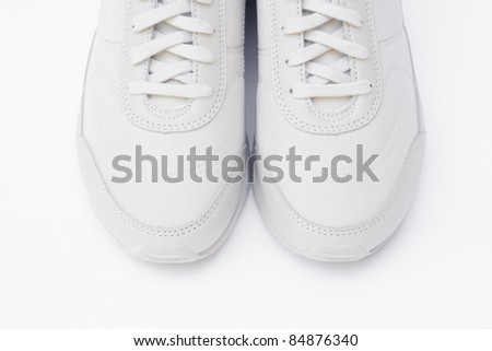 A pair of white running shoes - stock photo