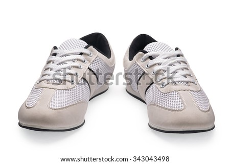 A pair of white sports shoes with shoelace on a white background
